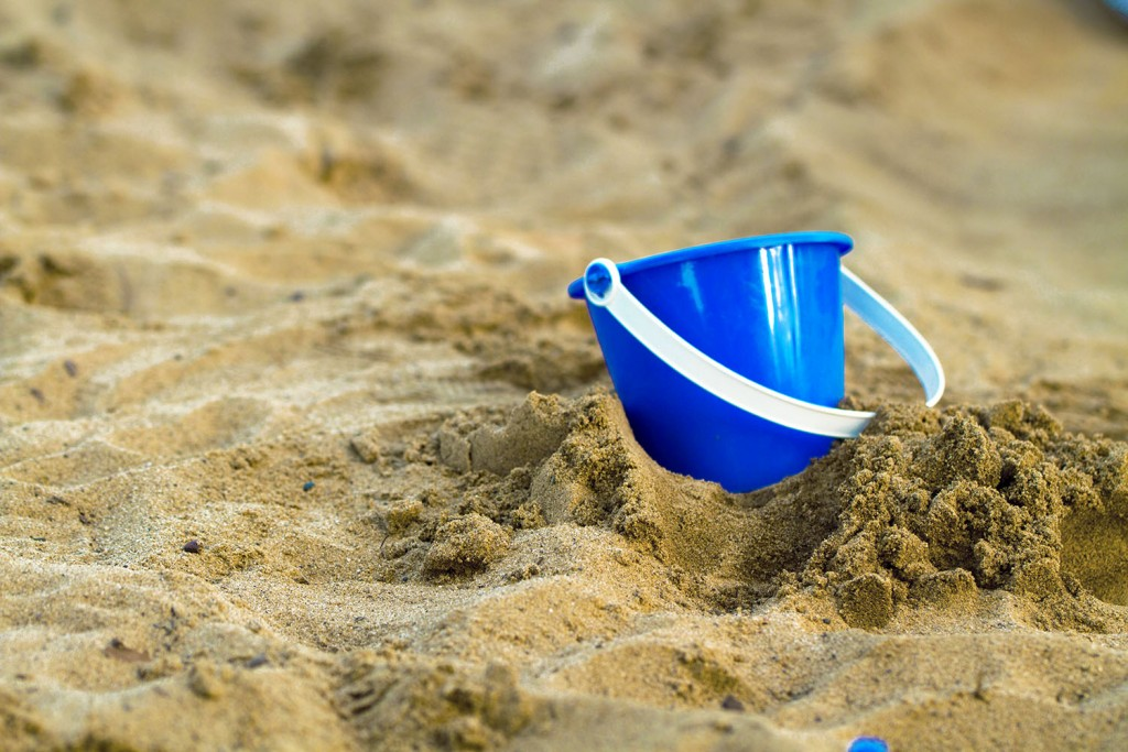 #196384267 Bucket in Sand